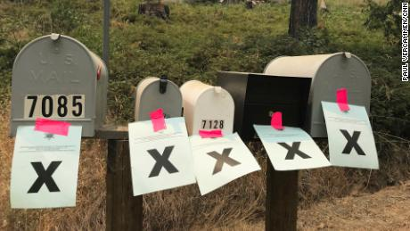 "Mailboxes of residences that have been evacuated are marked with an ""X."""