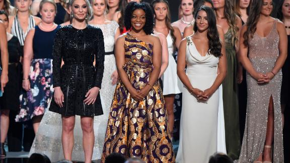 Former gymnast Sarah Klein, former Michigan State softball player Tiffany Thomas Lopez and gymnast Aly Raisman, from left in front, and others who suffered sexual abuse, accept the award.