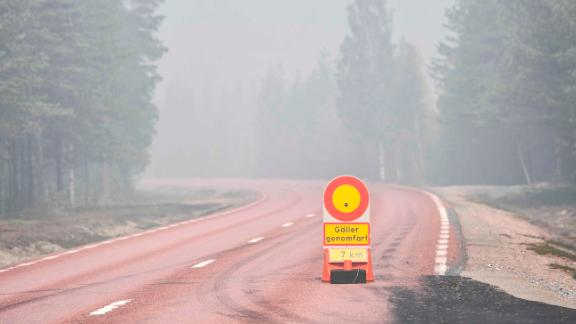 A road is closed to traffic Wednesday near Ljusdal because of forest fires.