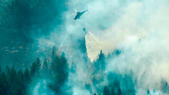 Firefighters use a helicopter to tackle a forest fire Wednesday near Ljusdal in central Sweden.