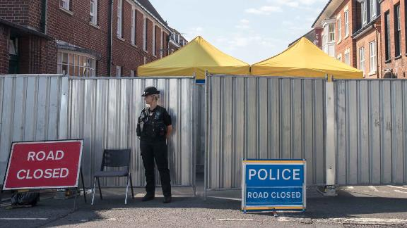 SALISBURY, ENGLAND - JULY 09: Police stand guard on a cordon outside the John Baker House Sanctuary Supported Living in Salisbury on July 9, 2018 in Wiltshire, England. Police have launched a murder enquiry after Dawn Sturgess, 44, died after being exposed to the nerve agent Novichok.  In March, Russian former spy Sergei Skripal and his 33-year-old daughter Yulia were poisoned with the Russian-made Novichok in the town of Salisbury. (Photo by Matt Cardy/Getty Images)