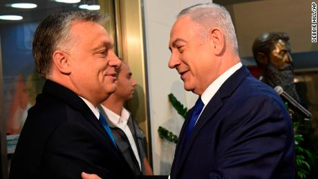 Orban is welcomed by Netanyahu upon his arrival at the prime minister's office in Jerusalem on Thursday.