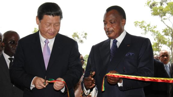 China's new President Xi Jinping (L) and Congo's Denis Sassou Nguesso President cut the ribbon on March 30, 2013, during Xi's first foreign trip.