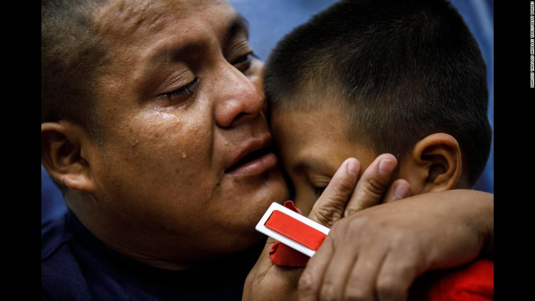 "Hermelindo Che Coc cries as he is reunited with his 6-year-old son, Jefferson, in the Los Angeles area on Saturday, July 14. The Guatemalans were separated at the US-Mexico border nearly two months ago as part of the Trump administration's ""zero-tolerance"" immigration policy."