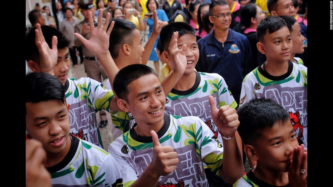 "Boys on the Wild Boars soccer team arrive for a news conference on Wednesday, July 18, a week after <a href=""https://www.cnn.com/2018/07/04/world/gallery/thailand-cave-rescue/index.html"" target=""_blank"">they were rescued from a flooded cave</a> in northern Thailand. Twelve boys and their coach were trapped in the cave for nearly three weeks."