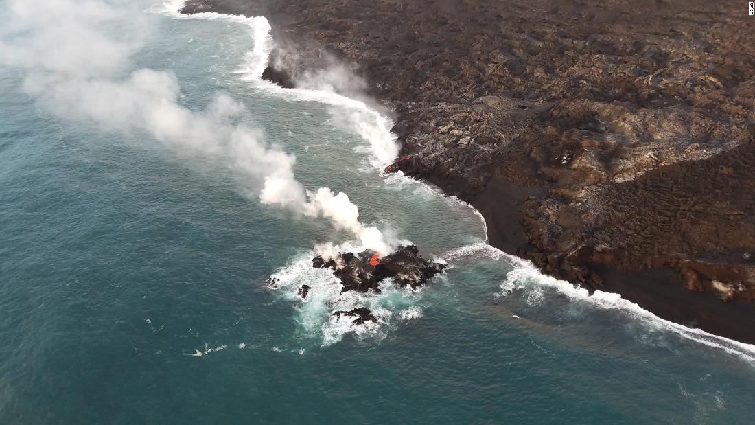 "Lava flowing from the Kilauea volcano <a href=""https://www.cnn.com/2018/07/16/us/new-island-lava-hawaii-wxc-trnd/index.html"" target=""_blank"">created a tiny new island</a> off the coast of Hawaii's Big Island. This image, posted by the US Geological Survey on Friday, July 13, shows the new island of lava just off the eastern side of the Big Island."