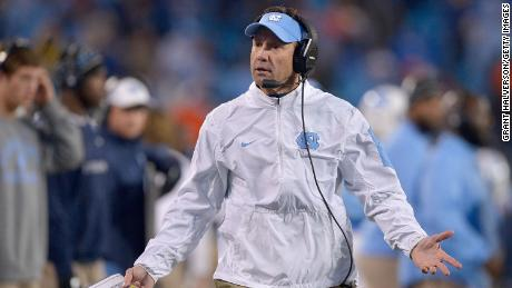 CHARLOTTE, NC - DECEMBER 05:  Head coach Larry Fedora of the North Carolina Tar Heels argues with the officials after his team was called offsides on a onside kick during the final minute of the Atlantic Coast Conference Football Championship against the Clemson Tigers at Bank of America Stadium on December 5, 2015 in Charlotte, North Carolina. Clemson won 45-37.  (Photo by Grant Halverson/Getty Images)
