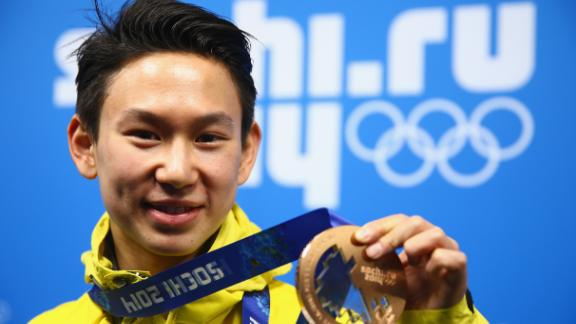 SOCHI, RUSSIA - FEBRUARY 15:  Bronze medalist Denis Ten of Kazakhstan celebrates during the medal ceremony for the Men's Figure Skating on day 8 of the Sochi 2014 Winter Olympics at Medals Plaza on February 15, 2014 in Sochi, Russia.  (Photo by Clive Mason/Getty Images)