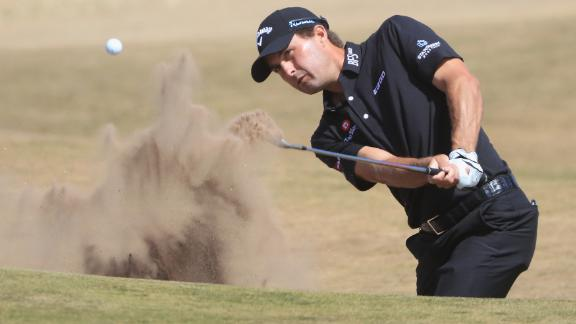 Kisner hits a bunker shot Thursday. He was the first-round leader after a 5-under 66. Three people were behind him at 4-under.