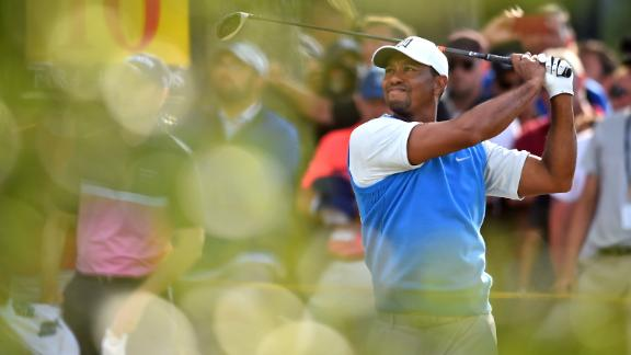 Woods tees off from No. 10 during the first round on Thursday. It was his first time back at the Open since 2015.