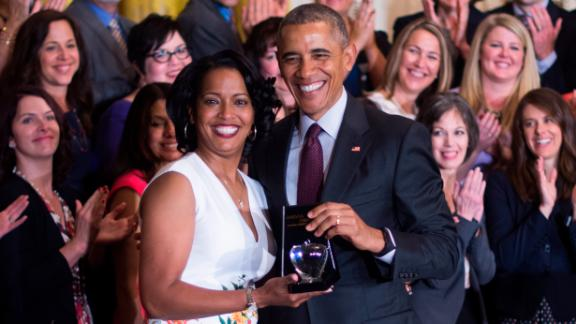 Jahana Hayes (L), a high school history teacher from Waterbury, CT, celebrates winning the 2016 National Teacher of the Year with President Barack Obama during an event at the White House, May 3, 2016. (JIM WATSON/AFP/Getty Images)