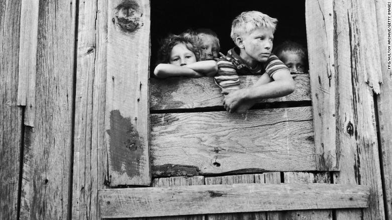 A group of children at the window of a shack in the U.S. in 1939.