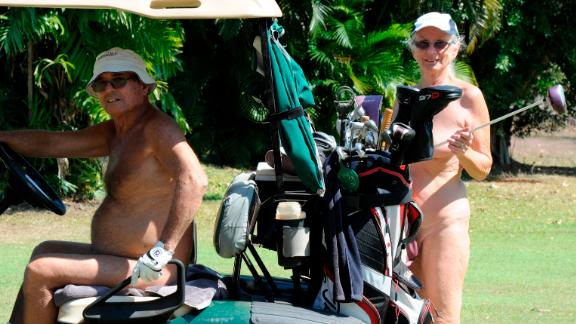 Although attendees had carts to transport their clubs, one golfer bravely carried them on his bare shoulder.