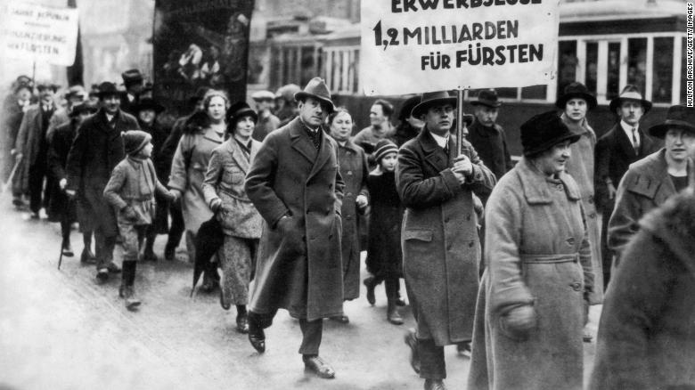 Male and female protesters during a demonstration by unemployed people in Berlin, Germany, in 1930.