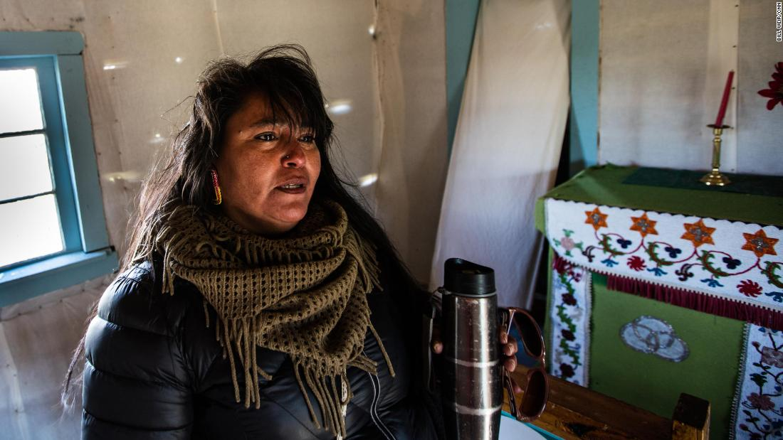 Faith Gemmill, a Neetsaii Gwich'in tribal member, inside the old church in Arctic Village.