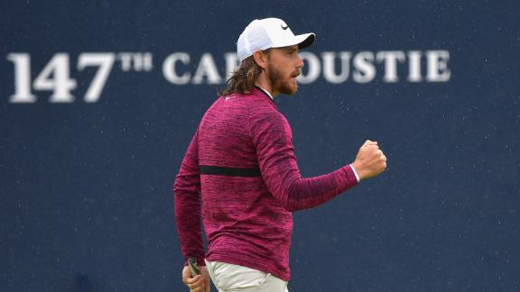 Tommy Fleetwood pumps his fist after a birdie on No. 18 on Friday. He finished with a 65.