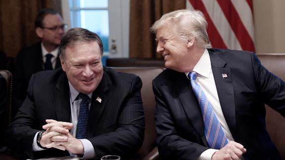 WASHINGTON, DC - JULY 18: (AFP OUT)  Secretary of State Mike Pompeo and President Trump share a laugh during a cabinet meeting with U.S. President Donald Trump in the Cabinet Room of the White House, July 18, 2018 in Washington, DC. (Photo by Olivier Douliery-Pool/Getty Images)