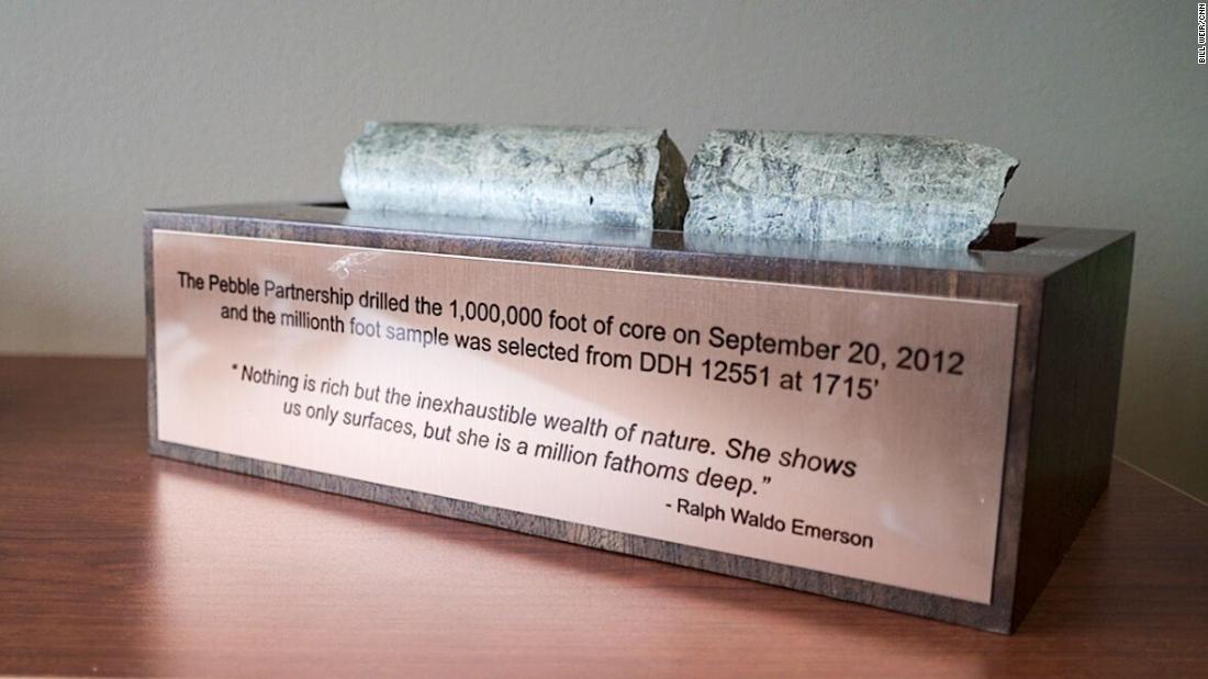 A core sample from the proposed Pebble Mine is mounted above a quote from Ralph Waldo Emerson, a defender of the natural world.