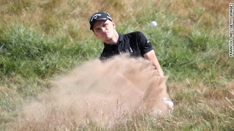 Ash Turner of England hits a bunker shot during the first round of the Open Championship in Scotland.