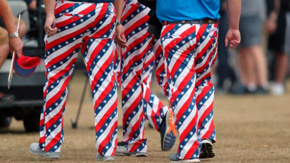 Fans don USA-themed trousers on the third day of the Open.