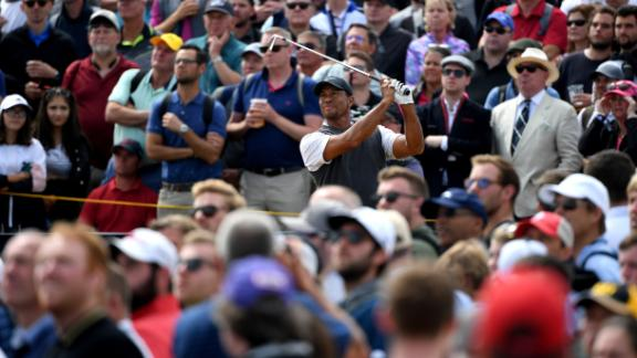 Woods tees off on the fifth hole Saturday.