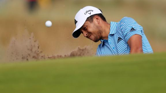 Xander Schauffele chips from a bunker during the third round.
