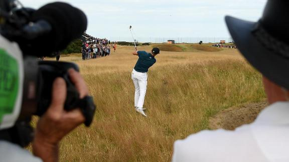 Cameramen film Spieth's second shot on the 14th hole Saturday.
