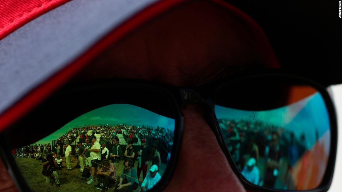 Fans are reflected in sunglasses on Saturday.