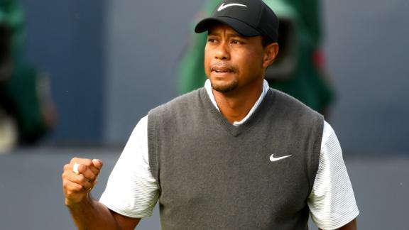 Woods celebrates on the 18th hole Saturday.