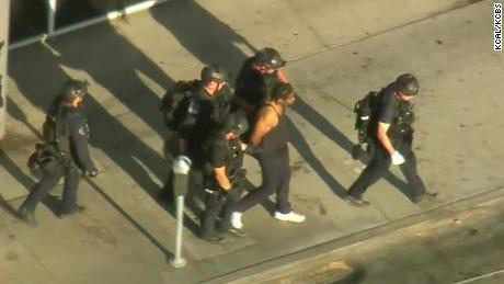 Aerial photography showed police continued to handcuff the suspect.