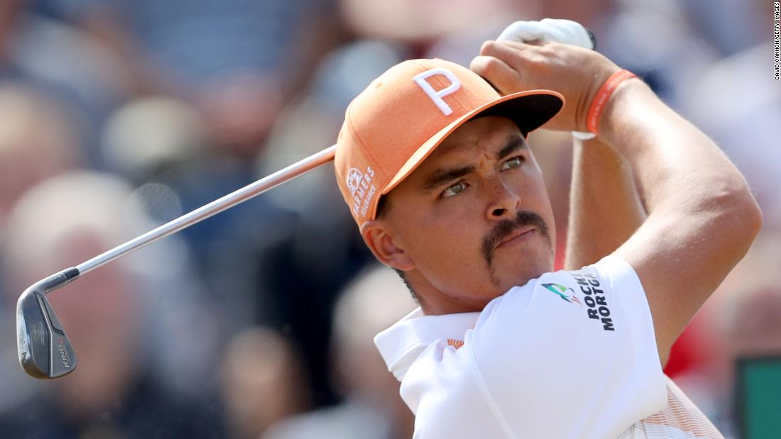 Rickie Fowler plays a tee shot on the third hole Sunday.