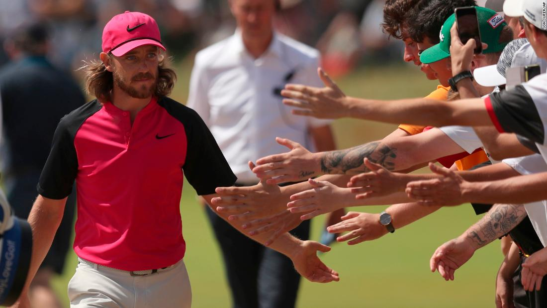 Tommy Fleetwood greets fans as he walks to the second hole on Sunday.