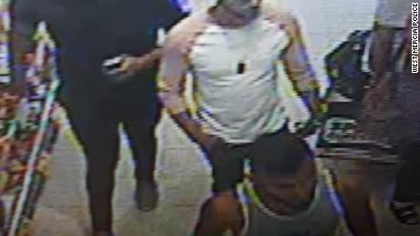 Police have released a photo of three men they want to speak to after a three-year-old boy was seriously injured in a suspected acid attack in a Worcester shop on July 21.
