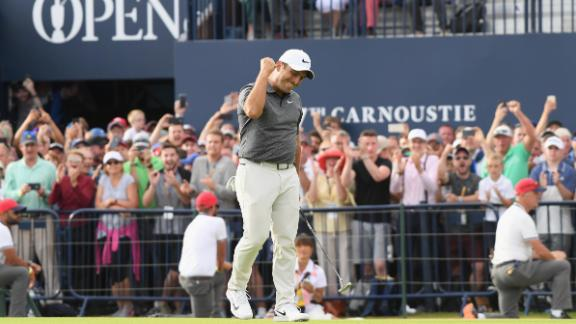 Francesco Molinari celebrates after sinking a putt on the last hole of the Open Championship on Sunday, July 22. He won by two strokes for his first career major.