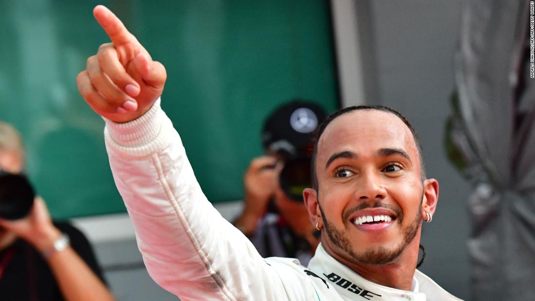 Hamilton celebrates an extraordinary comeback win at the German Grand Prix to give him a 17-point championship lead as title rival Sebastian Vettel crashed out