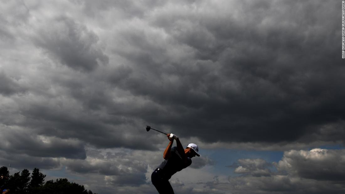 Dustin Johnson hits a tee shot during the first round of the Open Championship on Thursday, July 19.