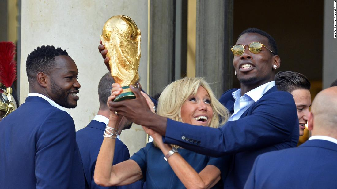 france u0026 39 s first lady  brigitte macron  lifts the world cup