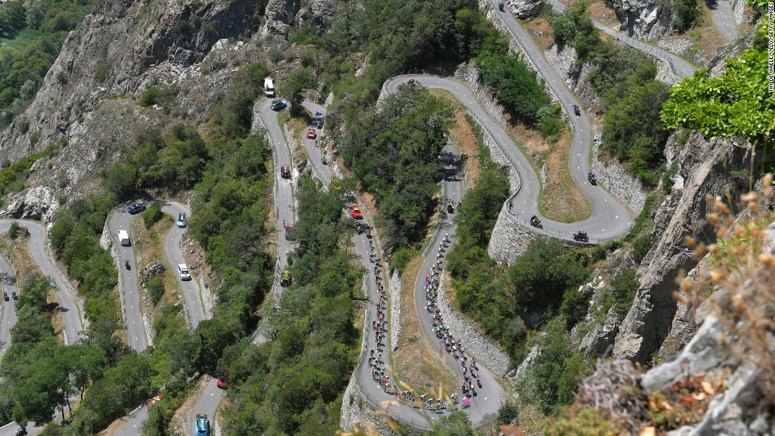 Cyclists climb a winding mountain road during the 12th stage of the Tour de France on Thursday, July 19.