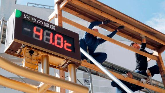 An outdoor thermometer reads 41.0 degrees Celsius (105.8 degrees Fahrenheit) in Kumagaya city, north of Tokyo, Monday, July 23, 2018.