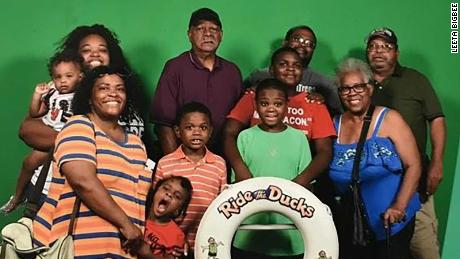 Tia Coleman and 10 of her relatives got on a duck boat to take a tour of Table Rock Lake during their family vacation. Only she and her nephew survived when the boat sank.  Back - Left to Right: Tia Coleman, holding her one-year-old Arya, Ray Coleman, Glenn Coleman (husband), Horace Coleman.   Front: Angela Coleman , Max, Evan (striped shirt), Reece (green shirt), Donovan Hall (behind Reece), Belinda Coleman.
