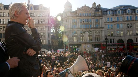 In October 2011, a month after WikiLeaks released more than 250,000 US diplomatic cables, Assange speaks to demonstrators from the steps of St. Paul