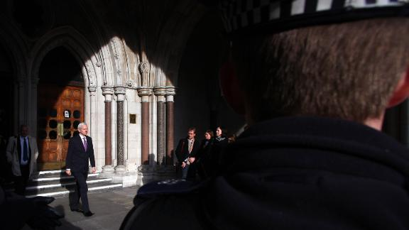Assange leaves the High Court in London in December 2011. He was taking his extradition case to the British Supreme Court.