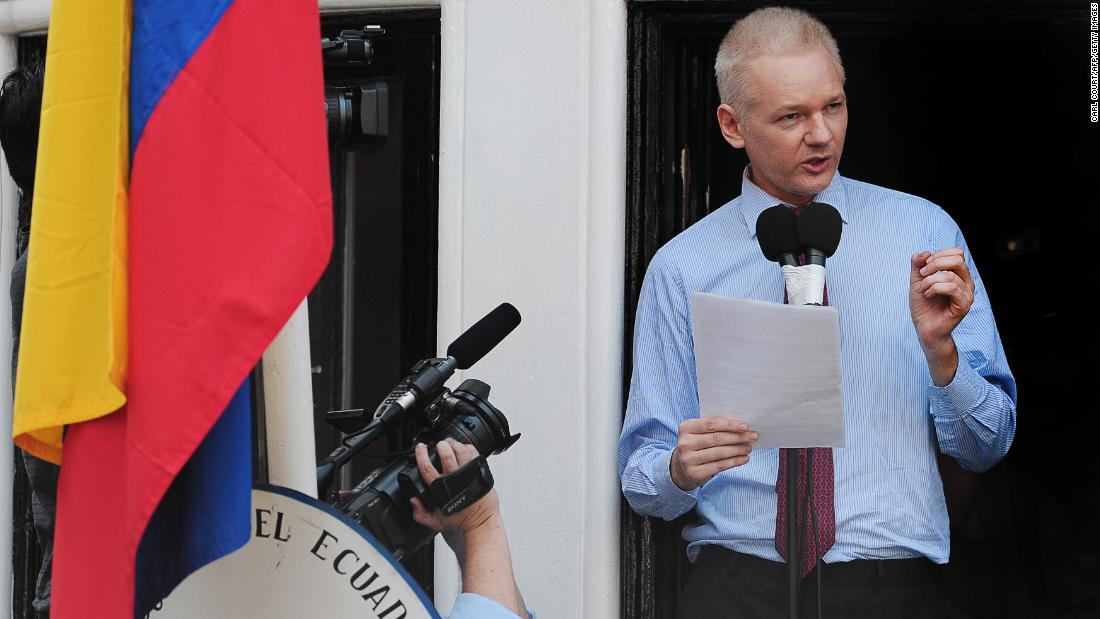 "Assange addresses the media and his supporters from the balcony of the Ecuadorian Embassy in London on August 19, 2012. A few days earlier, Ecuador announced that it had granted asylum to Assange. In his public address, Assange demanded that the United States drop its ""witch hunt"" against WikiLeaks."