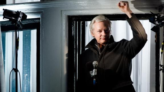 Assange speaks from a window of the Ecuadorian Embassy in December 2012.