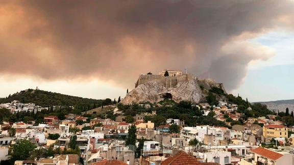 Smoke rises over Athens' ancient Acropolis hill on July 23.