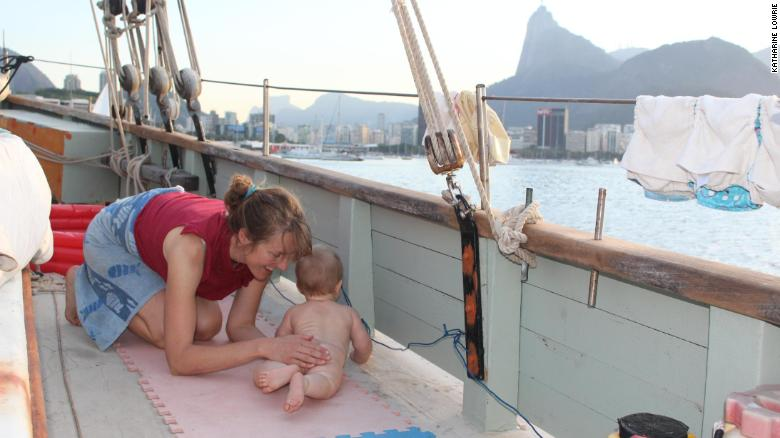Baby Theo playing on deck, with Rio de Janeiro in the background.