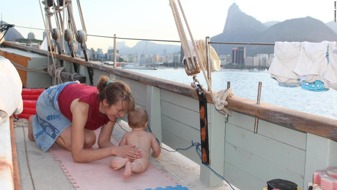"Theo lived aboard The Lista Light from the age of three months to almost a year. He's pictured playing on deck, with Rio de Janeiro in the background. ""We let him walk and crawl around on deck when it was calm, but one of us was always close,"" said Katharine. ""His balance was amazing -- he could stand up holding on to the swaying fencing."""