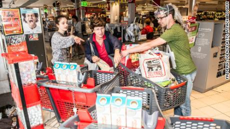 The movement has spread around the world. Pictured, a 'plastic atack' at a supermarket in Belgium.