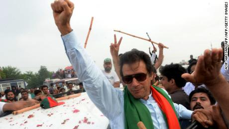 Pakistani cricketer-turned-politician Imran Khan gestures as he leads a protest march to Islamabad on August 15, 2014.