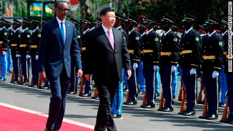 Chinese President Xi Jinping (C) inspects a guard of honor, accompanied by Rwandan President Paul Kagame (L), upon his arrival at the Urugwiru State house in Kigali on July 23, 2018, during a two-day state visit in Rwanda.
